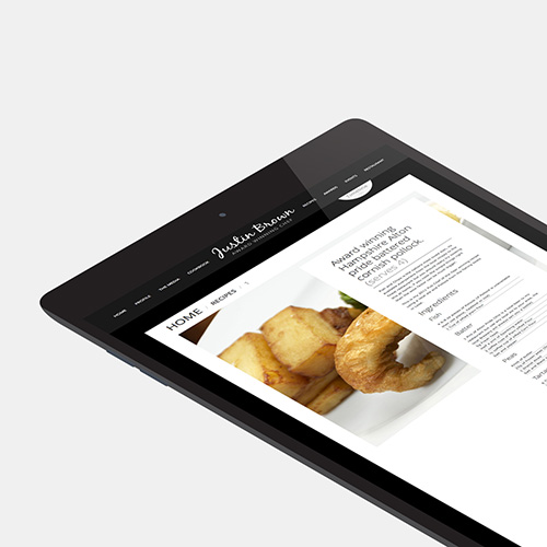 Justin Brown Chef website shown on a tablet