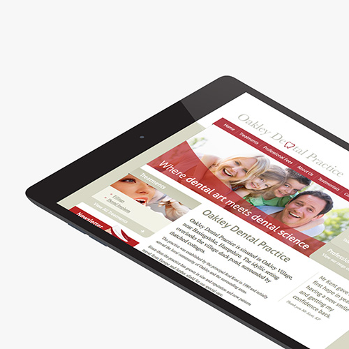 Oakley Dental Practice website shown on a tablet