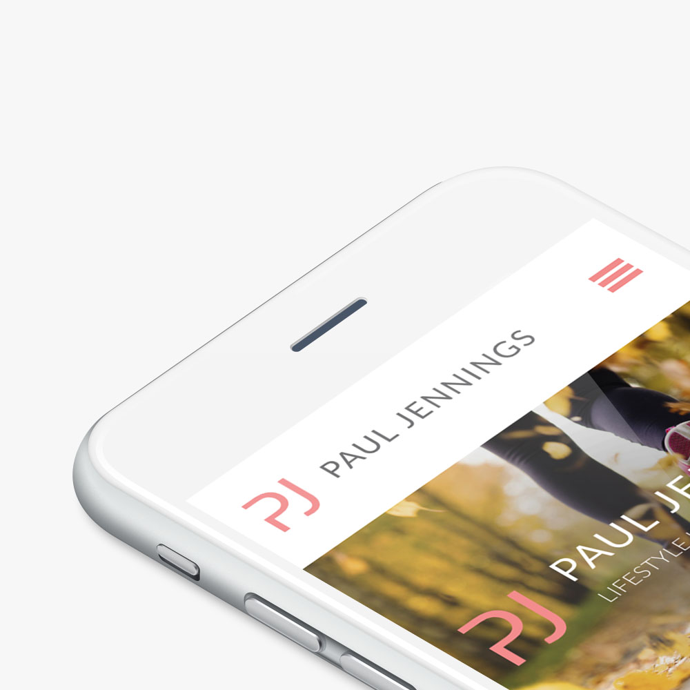 Paul Jennings Fitness website shown on a smartphone
